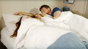 Girls In Bed dolly shot of couple lying in bed and talking stock footage video