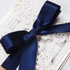 white and blue ribbon luxury pearl white laser cut wedding invitations with navy blue