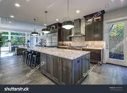 oversized kitchen islands modern kitchen brown kitchen cabinets oversized stock photo