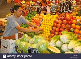 fruits and vegetables hang in a grocery shop in maralal kenya