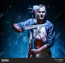 bloody halloween background bloody halloween theme crazy killer as bloody butcher with saw on