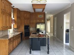 are wood kitchen cabinets outdated before and after a dated wood kitchen goes all white and