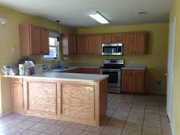 is behr marquee paint for kitchen cabinets makeover your builder grade cabinets like a pro motifbrophy