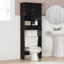 black wooden bathroom cabinet with double doors and shelf over