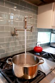 kitchen pot filler faucets kitchen tile backsplash home style kitchens stove