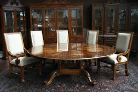 superb round dining table and chair set shown with optional chairs