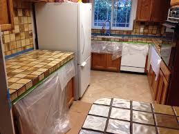 light and dark brown tile countertop backsplash white light and dark brown tile countertop backsplash white refrigerator dishwasher top mount stainless steel sink wall oven wooden cabinets