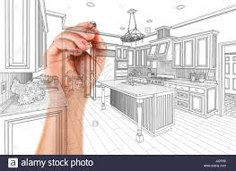 hand of architect drawing detail of custom kitchen design stock