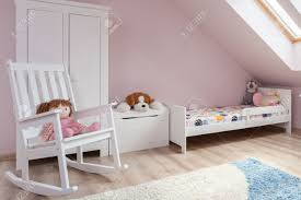 Rocking Bed Frame by Rocking Chair In Cute Room For Little Girl Stock Photo Picture