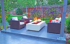 modern outdoor living space with steel fire pit and trellis mile