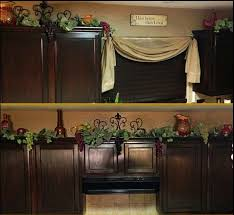 should i decorate on top of my kitchen cabinets pin by larraine henning on kitchen decor wine decor