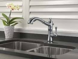 delta waterfall kitchen faucet delta faucet adds pull out and waterfall configurations to its