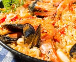 cuisiner une paella paëlla de valence recette familiale recette de paëlla de valence