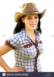 attractive teenage wearing cowboy hat and western shirt