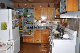 brown wooden kitchen cabinet and brown tile backsplash connected