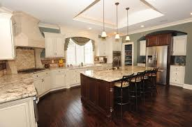 Single Pendant Lighting Over Kitchen Island by Exquisite Modern Kitchen Feat Brown Hardwood Built In Kitchen