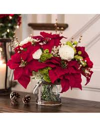 decorating gift giving with silk poinsettia accent