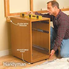 install cabinets like a pro the family handyman best ideas of marvelous kitchen cabinet base replacement photos best