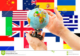 globe in on a background of flags from around the world stock