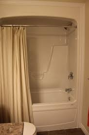 Chandelier Over Bathtub Safety by One Piece Acrylic Tub Shower Bathroom Features Pinterest