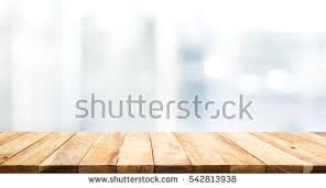 wood table wood table top on blur glass stock photo 542813938