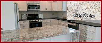kitchen granite island kitchen featuring different granite countertops and granite island