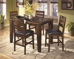 ashley larchmont burnished dark brown 5 piece dining room set
