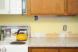 how to put up tile backsplash in kitchen a white subway tile backsplash green diy