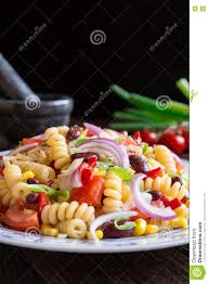 mexican pasta salad with red bean corn tomato onion and pepper