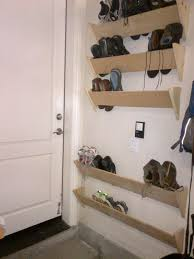 Garage Shoe Organization Ideas - homemade shoe racks for our garage walls by the house entrance
