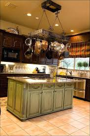 adding toppers to kitchen cabinets decorating above kitchen cabinets with greenery lighting options