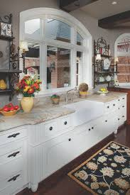 photos hgtv traditional kitchen with arched window and white photos hgtv traditional kitchen with arched window and white cabinets luxury homes interior design
