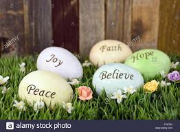 pastel easter eggs inspirational words on pastel easter eggs in grass stock photo