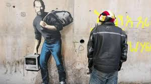 banksy s painting of steve jobs shines positive light on accepting refugees