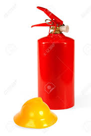 red fire extinguisher and a yellow toy fire helmet concept stock