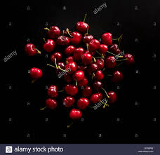 cherries on a black stone table in the kitchen high resolution