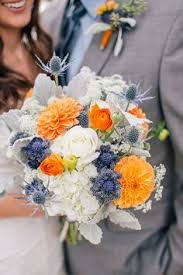 wedding flowers queanbeyan navy orange and grey bridal bouquet with textured flowers www
