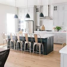 white kitchen with black island kitchen w grey island stools and white cabinets w