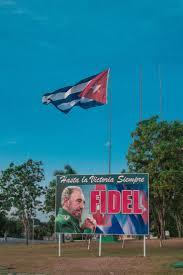 Che Guevara Flag The Cuban Flag Flies Over A Billboard To Fidel Castro In Santa