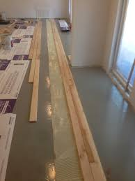 Laminate Flooring On Concrete Gluing Down Prefinished Solid Hardwood Floors Directly Over A Concrete