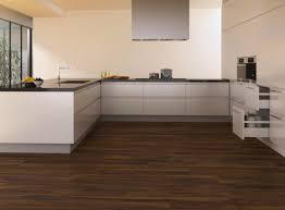 Basement Flooring Tiles With A Built In Vapor Barrier Vinyl Basement Flooring Ceramic Tile Vs Laminate In Bat Or Kitchen