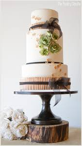 a romantic black and green vintage wedding cake by the pastry