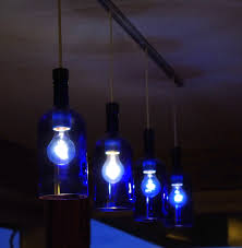 lights made out of wine bottles tig made this light fixture out of sky vodka bottles the things i