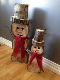 wooden snowman 37 cutest snowman décor ideas for this winter digsdigs