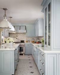 blue kitchen island with oak cabinets blue kitchen cabinets with calcutta gold subway tiles