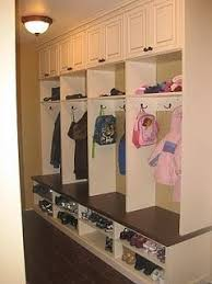 cabinet for shoes and coats room to sit room for shoes hooks for coats and backpacks extra