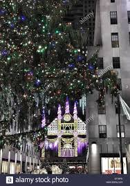 christmas tree and saks fifth avenue light show at rockefeller