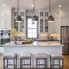 Kitchen Remodels With White Cabinets by Gray Kitchen Features Gray Shaker Cabinets Adorned With Brass
