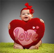valentines baby baby holding a heart plush for valentines day by