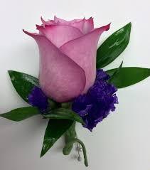 lavender roses lavender and purple statice boutonnière centerville florists